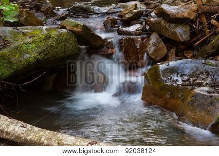 beautiful natural stream among stones.