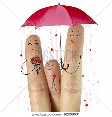 Father and son are giving flowers their mother staying under umbrella with falling hearts