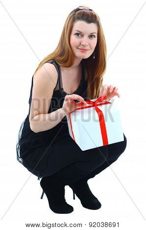 girl smiling holds a gift