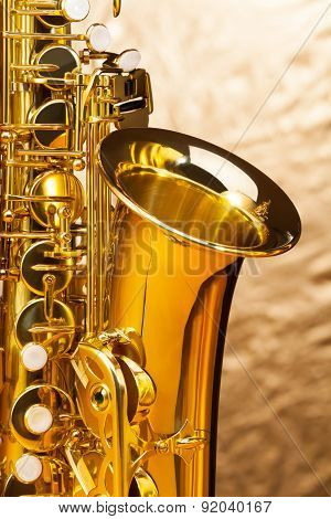 Alto saxophone with keys on silver background