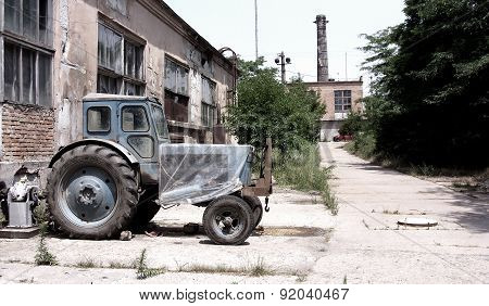 Dirty broken Chernobyl abandoned buildings, vacant lots, contaminated land, a tractor