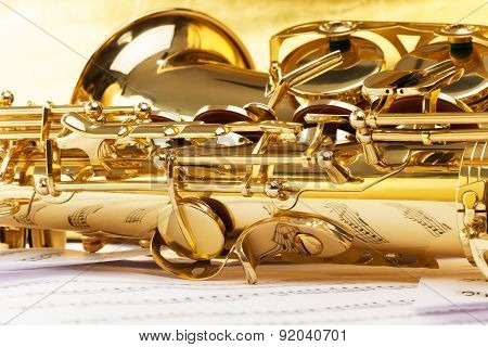 Saxophone part with musical notes reflecting on it