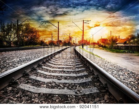 Railroad with pillars receding into the distance