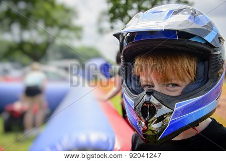 Young boy wearing a motorcycle helmet