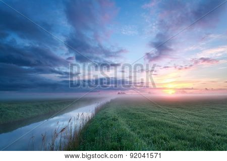 Misty Sunrise Over Meadow And River