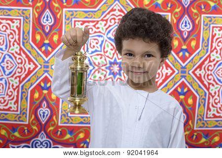 Happy Boy With Golden Lantern Celebrating Ramadan