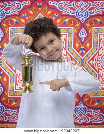 Happy Boy Pointing At Ramadan Lantern