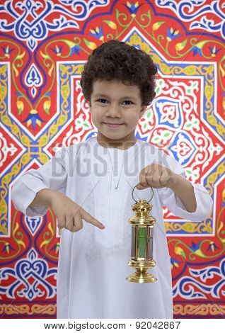 Happy Young Boy Pointing At Ramadan Lantern