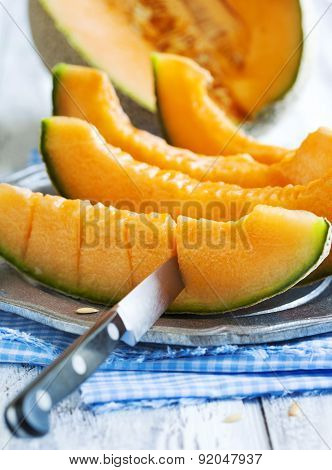 Cantaloupe Melon Slices On Metal Rustic Plate