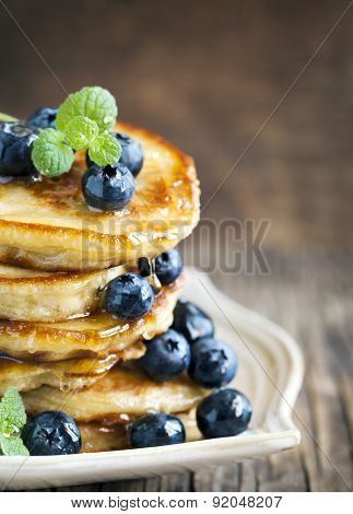 Stack Of Pancakes With Fresh Blueberry And Honey