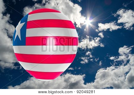 Balloon With Flag Of Liberia On Sky