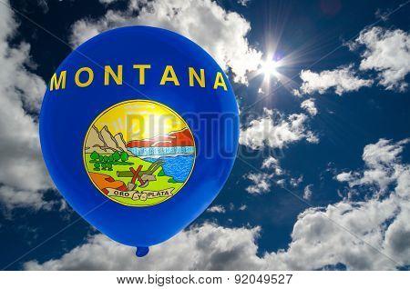 Balloon With Flag Of Montana On Sky