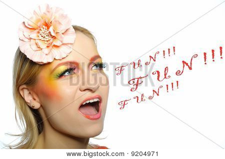Pretty Woman With Creative Eye Make-up Screaming Word Fun. Copy-space