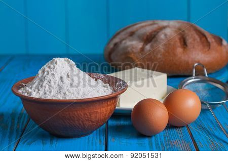 Baking bread in rural kitchen - dough recipe ingredients eggs, flour, butter and whisk, screen on vi
