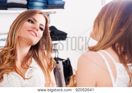 Beautiful teenage girl looking in a mirror