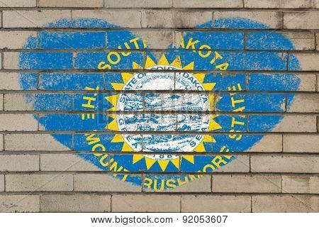 Heart Shape Flag Of South Dakota On Brick Wall