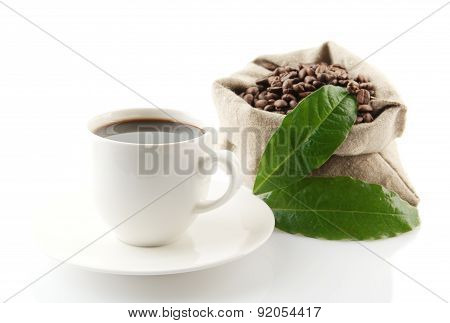 Sack Full Of Coffee Beans With Green Leaves And Coffee Cup