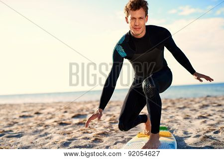 Surfer Showing Proper Stand Position On Surfboard