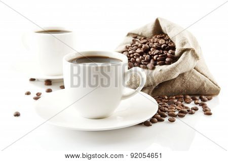 Cups Of Coffee With Saucer With Bag With Coffee Beans On White
