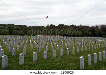 Gravestones and the American Flag at the Lincoln National Cemetary