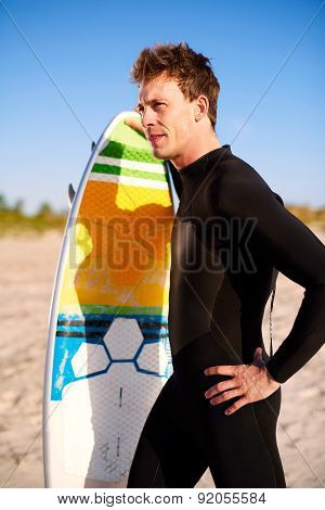 Athletic Fit Young Surfer With His Surfboard