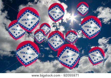 Many Balloons With Arkansas Flag On Sky