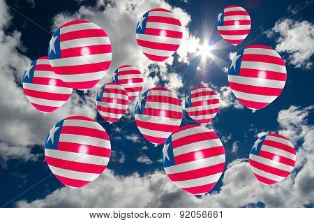 Many Balloons With Liberia Flag On Sky