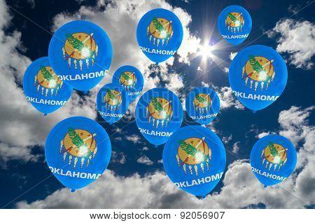Many Balloons With Oklahoma Flag On Sky
