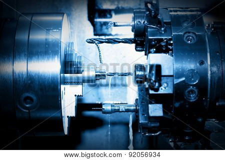 Industrial CNC drilling and boring machine at work close-up. Industry concept, blue tone.