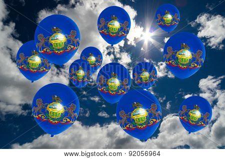Many Balloons With Pennsylvania Flag On Sky