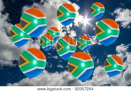 Many Balloons With South Africa Flag On Sky