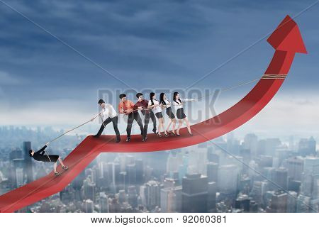 Business People Pulling Financial Graph