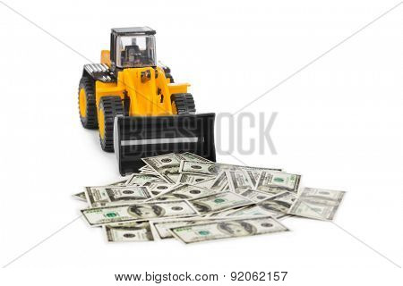 Toy loader and money isolated on white background
