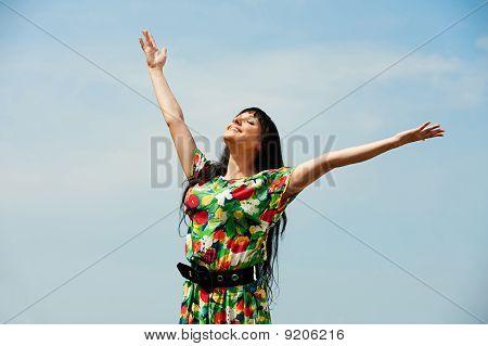 Happy Woman Against Blue Sky
