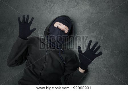 Male Burglar Expressing Give Up