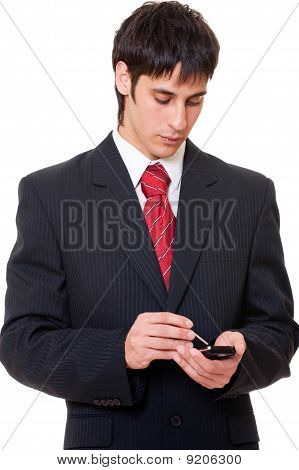 Serious Businessman With Palmtop