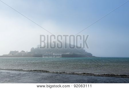 Tide Coming Onto The Beach In Front Of St Michaels Mount