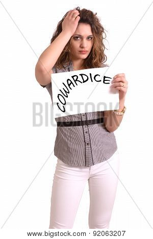 Uncomfortable Woman Holding Paper With Cowardice Text