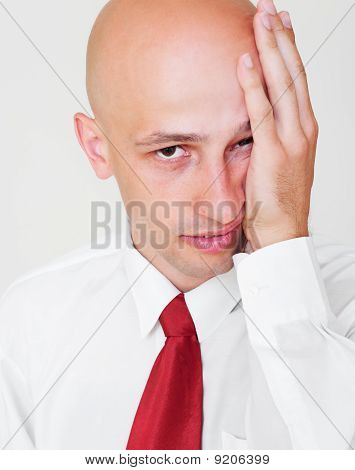 Weary Businessman Over Grey Background