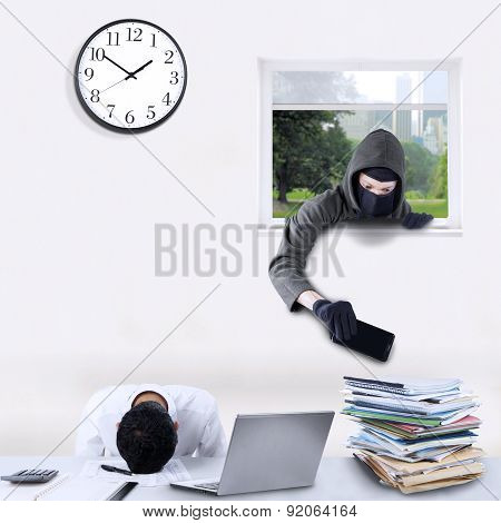 Robber Stealing Cellphone In Office