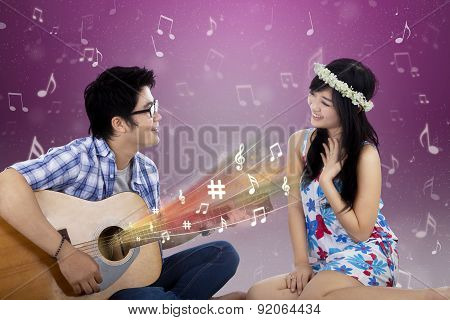 Romantic Couple With Guitar Singing Together