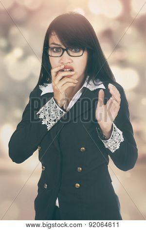 Scared Businesswoman With Bokeh Background