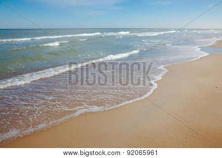 Sandy beach with big waves