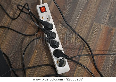 Plugged in electric devices in an extension cord