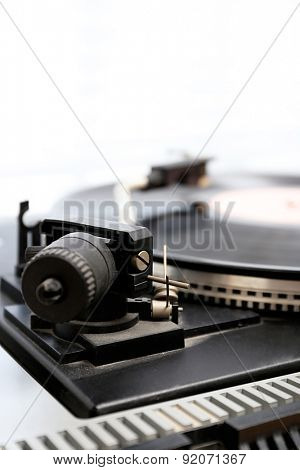 Gramophone with a vinyl record, closeup