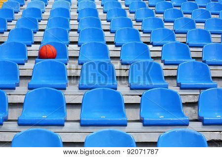 Basketball ball on stadium seat