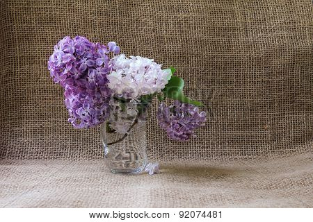 Still-life With A Bouquet Of Lilacs. Background With Place For Inscriptions.