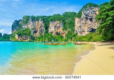 Railay Beach, mogotes, long tail boats in Thailand