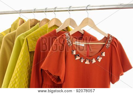Set of casual female fashion clothing on hangers