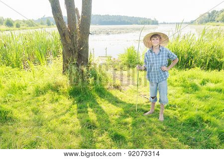 Posing Teenage Angler Boy With Handmade Green Twig Fishing Rod In Hand